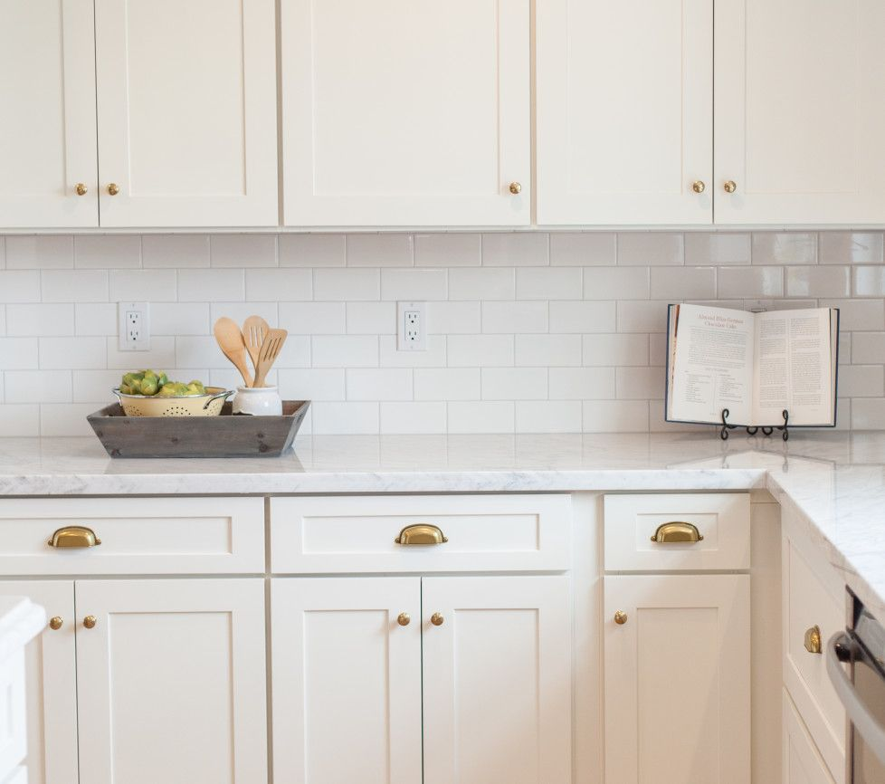 white subway tile white cabinets marble counter and brushed gold hardware by rafterhouse in on kitchen cabinets gold hardware id=78782