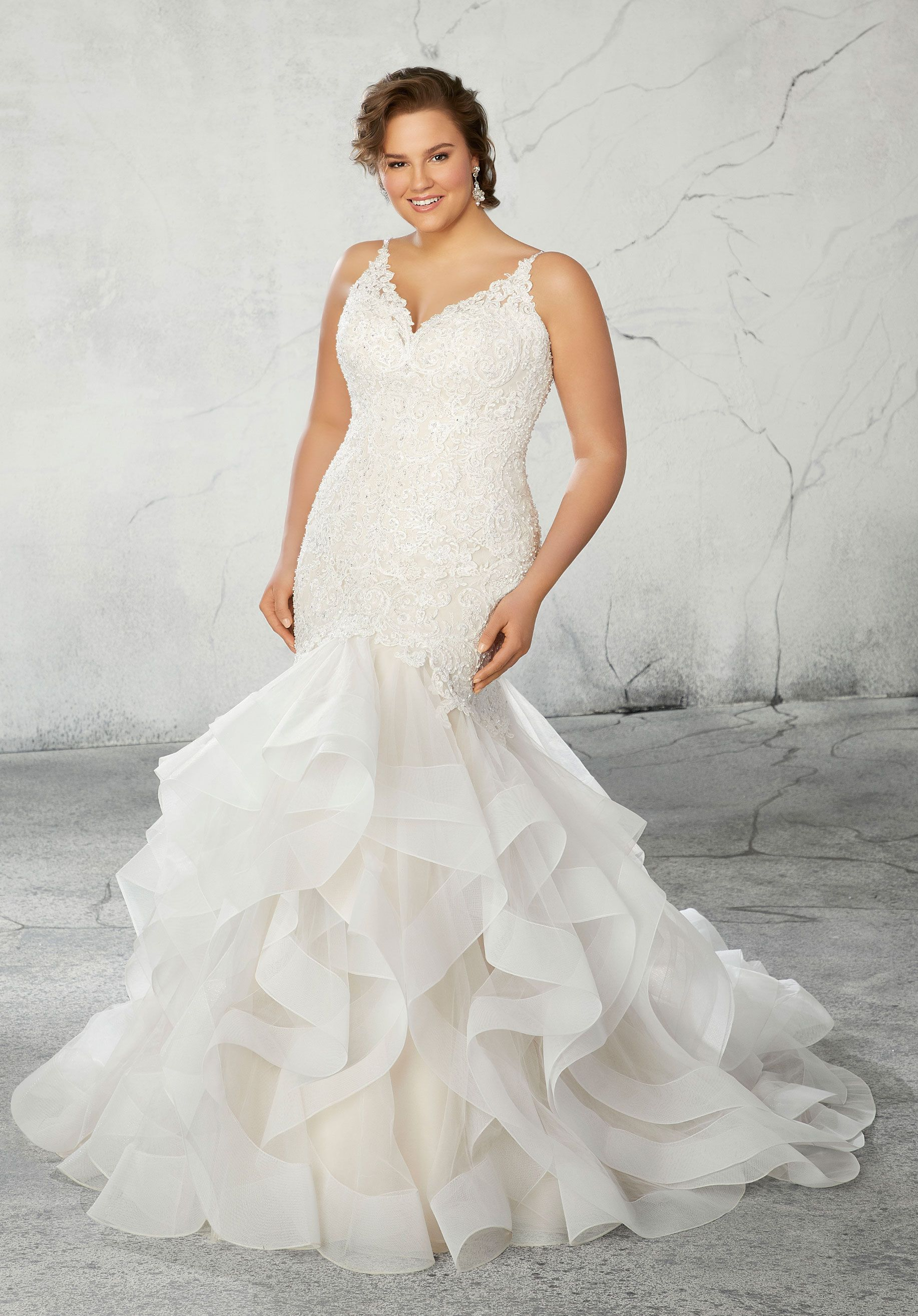 This plus size wedding dress features thin beaded straps