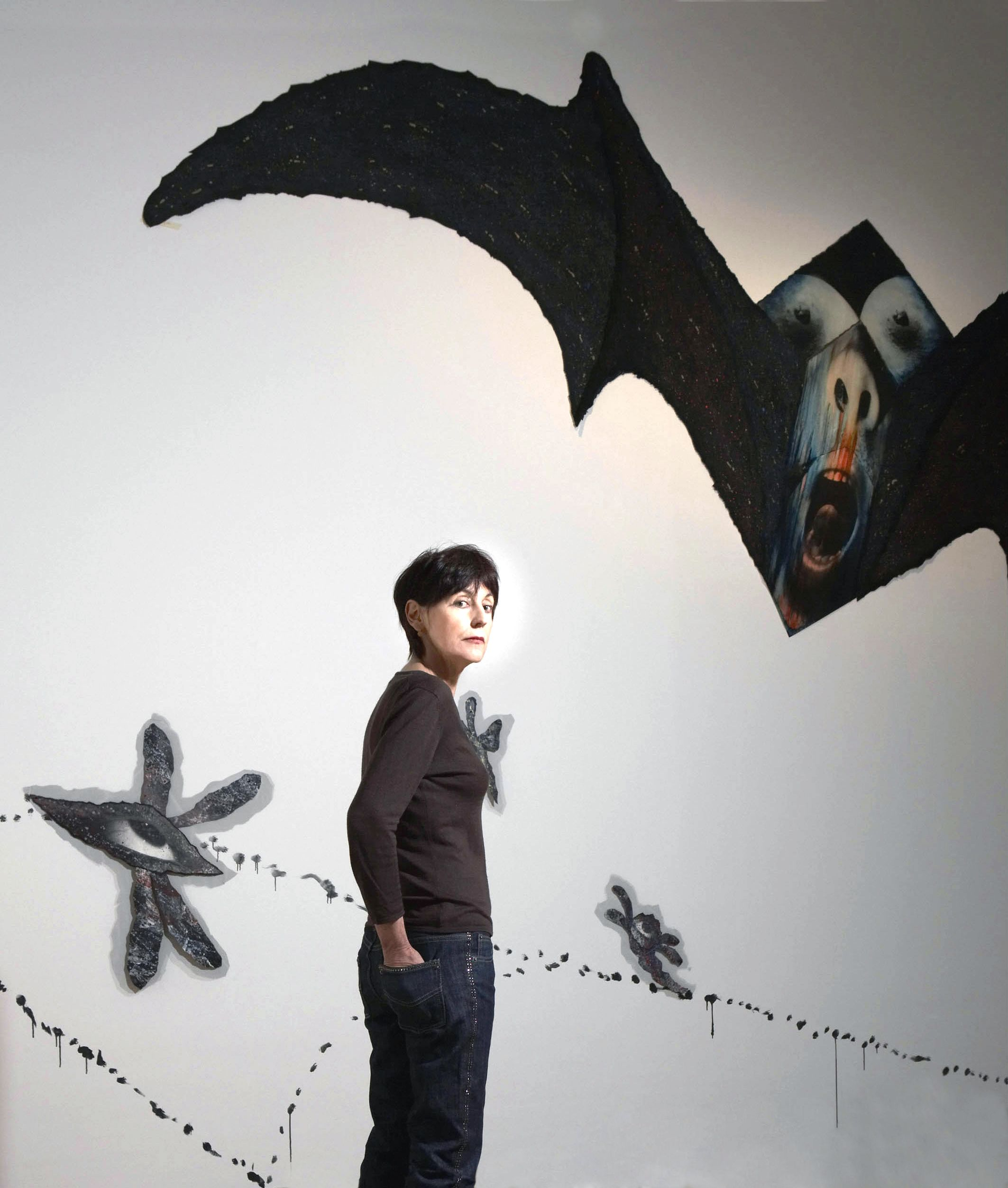 Portrait of Annette Messager with her work Chimeras