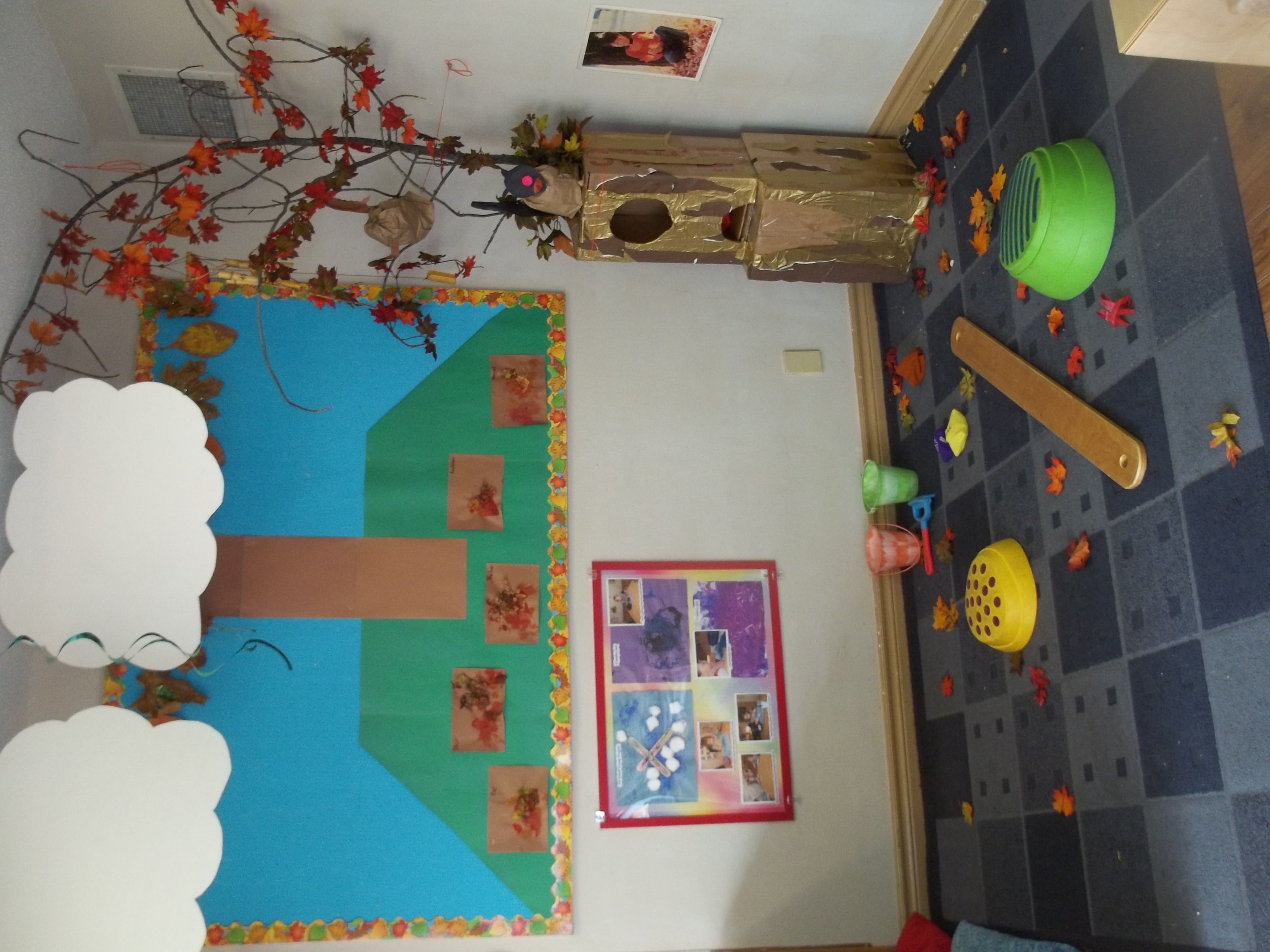 The leaves are falling! The toddler room gross motor center has become a fall park. Toddlers are able to practice climbing and balancing on stepping stones and 'logs', or collect and rake leaves sprinkled on the floor.
