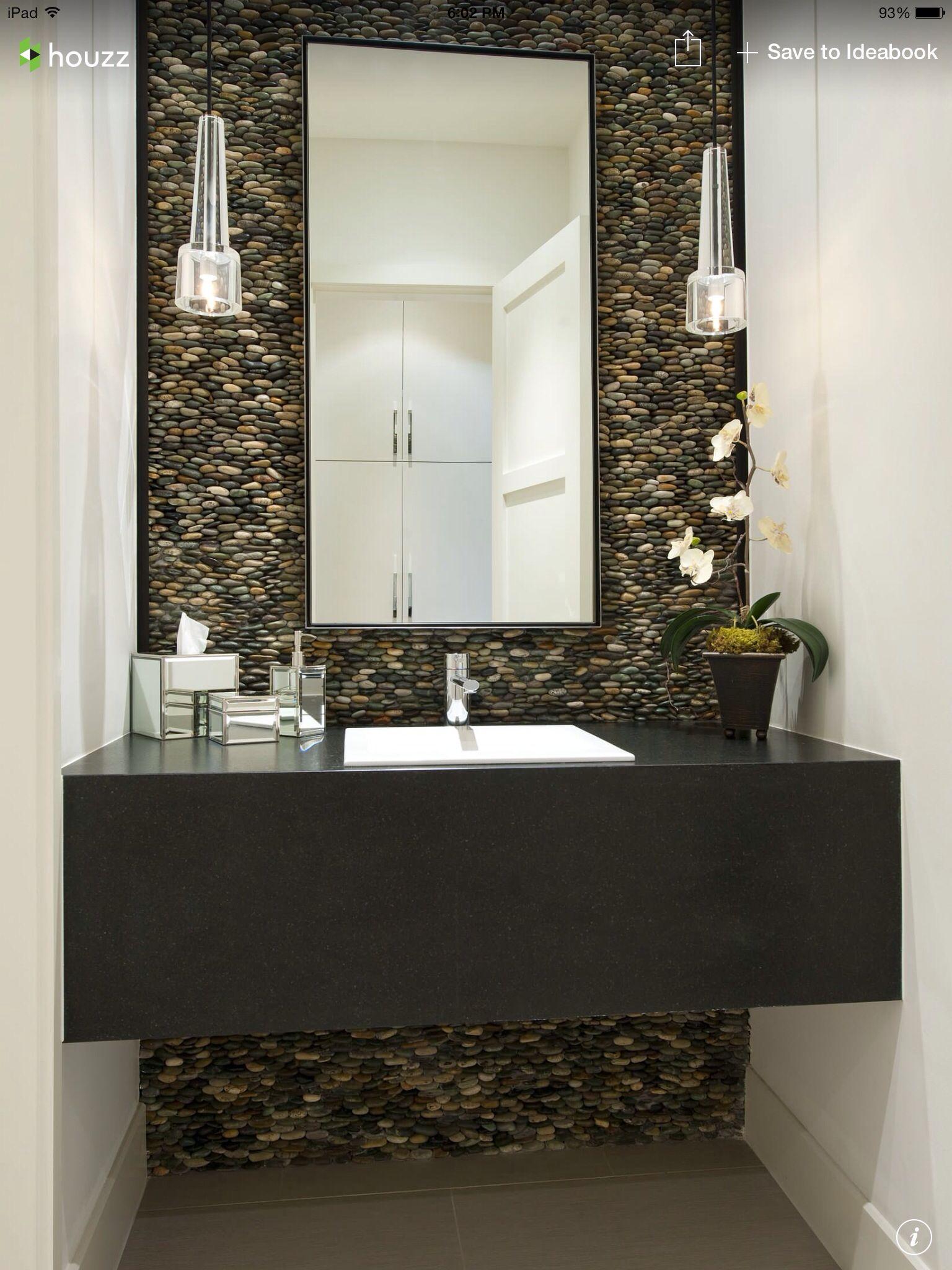Half bath stacked pebble backsplash, hanging lights