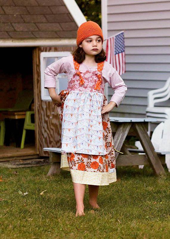 My daughter wearing her EmilyAnnsKloset knot dress. Whimsical Fall Apron Knot Dress by EmilyAnnsKloset on Etsy