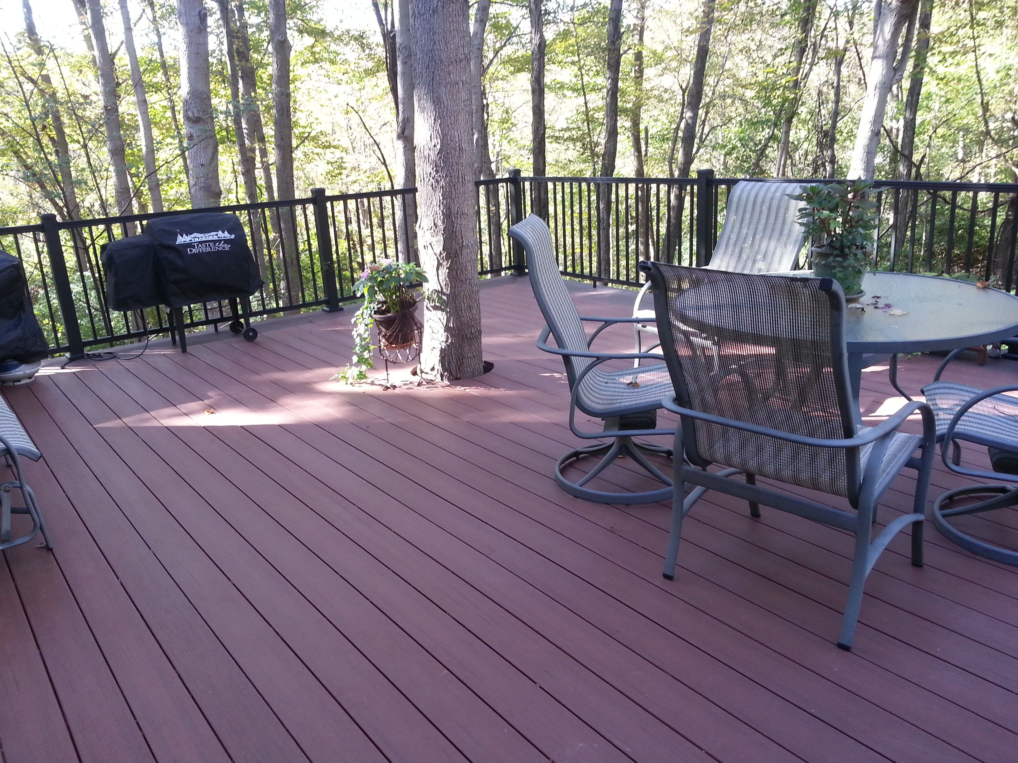 Azek Rosewood Deck with Acacia Triple Picture Frame Accent & Facia. Aluminum American Rail Handrail System.