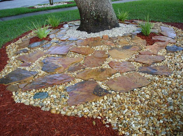 beautiful examples of using mulch  rocks and pavers in florida as garden designs