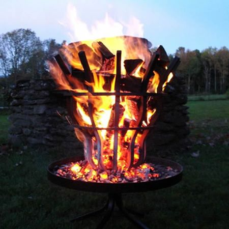 The Grate Wall Of Fire Tall Pit Elevated Ember Chamber Allows For A Natural Filtration Heat Emitting Embers To Bottom