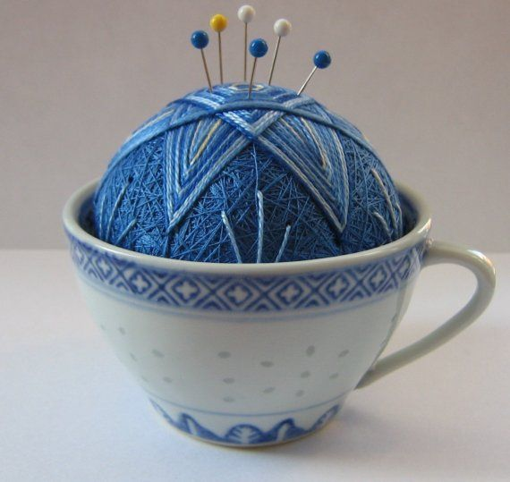 gorgeous blue pincushion in white and blue china cup