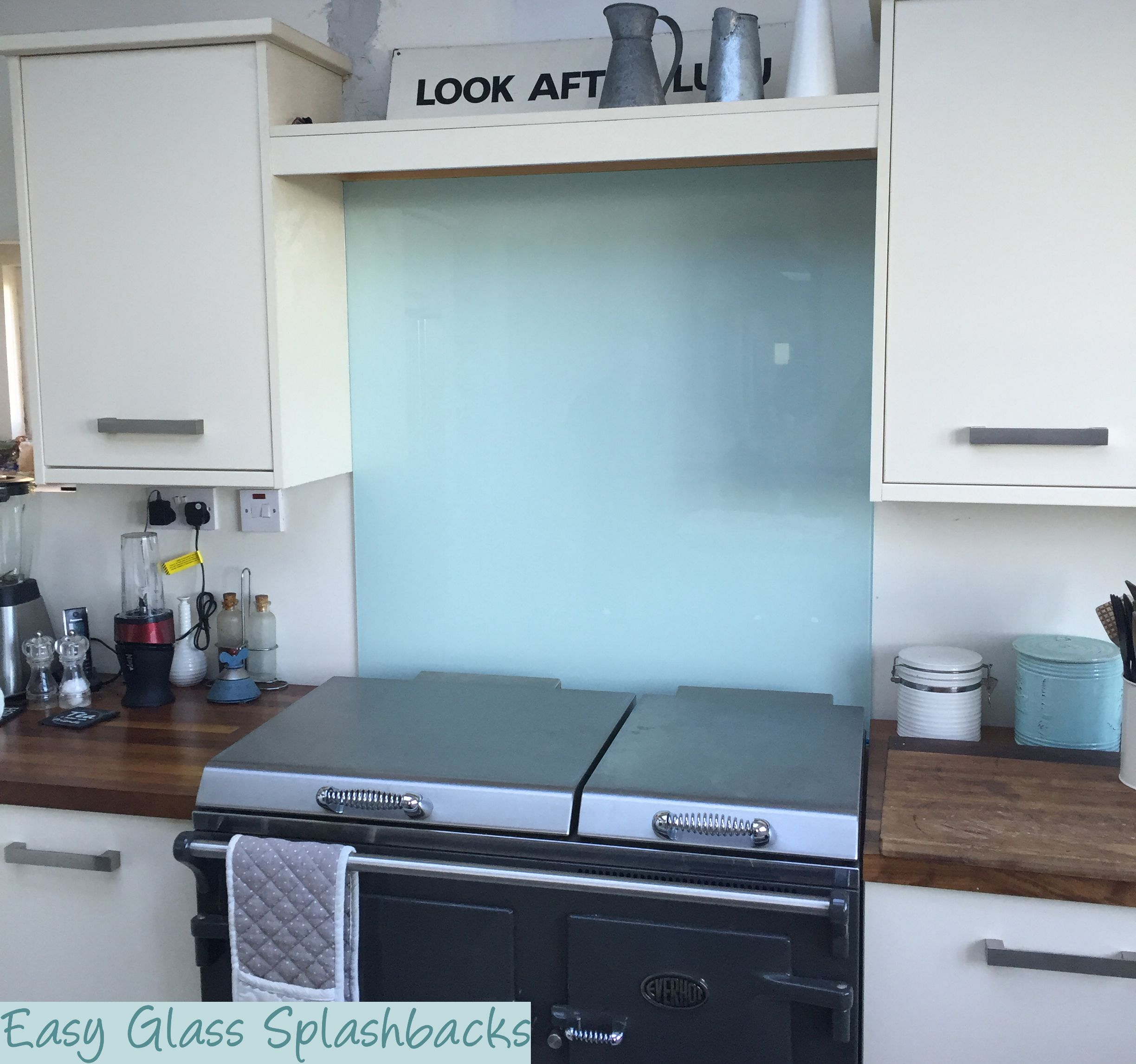 Glacier Blue coloured glass splashback in a White Kitchen with ...
