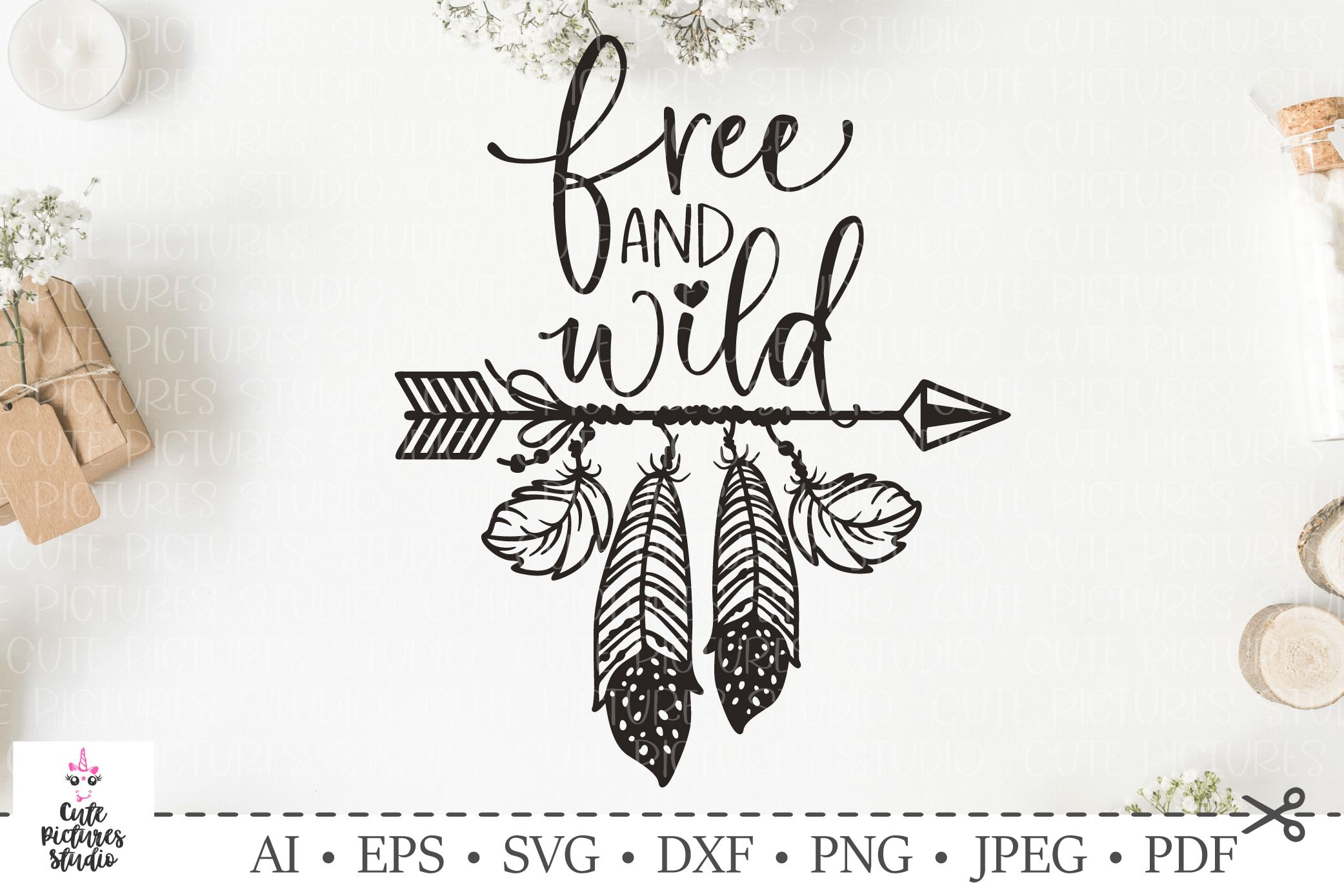 Lettering 'Wild and Free'. Arrow with feathers. Boho style