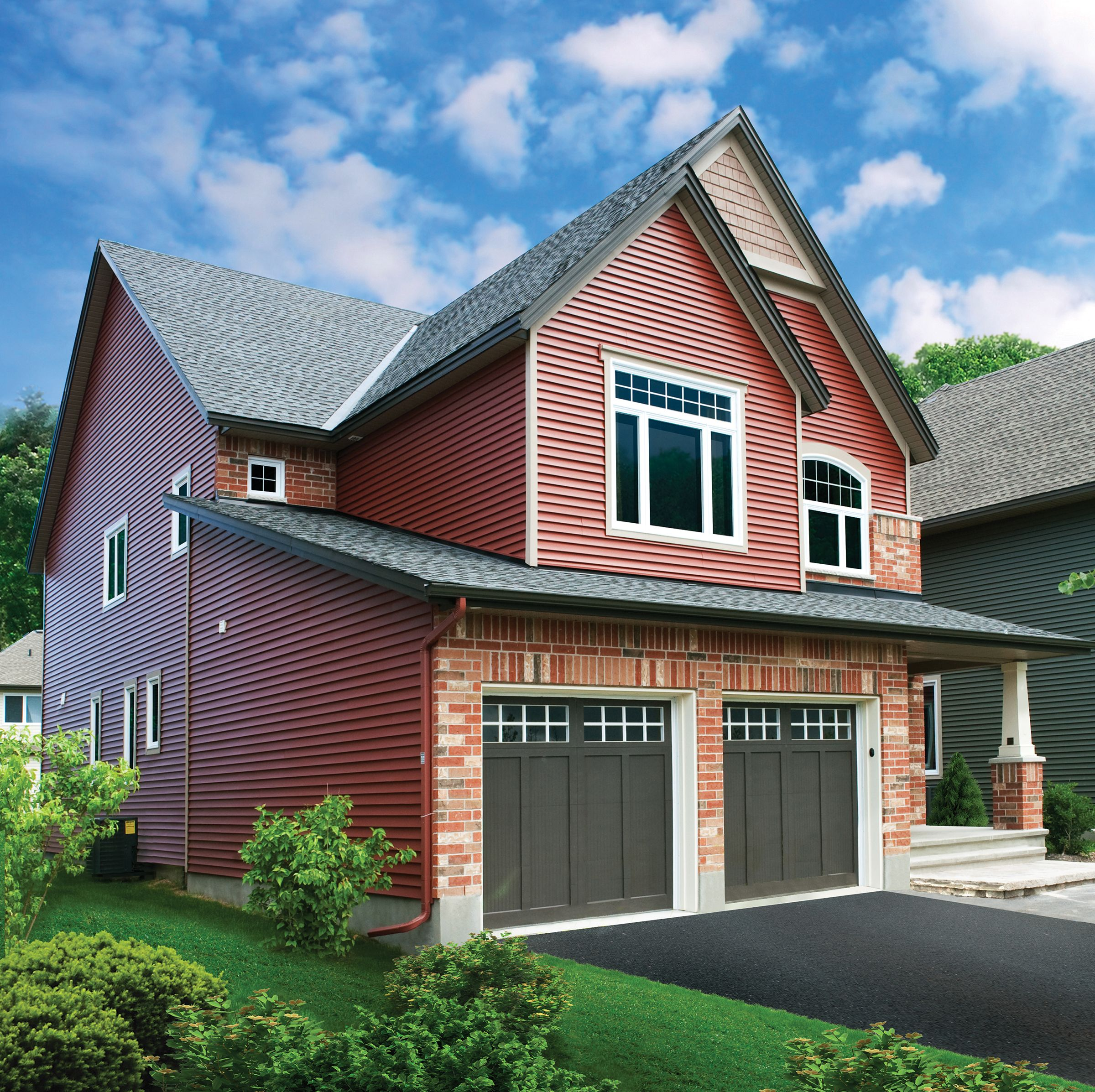 Venetian Red Vinyl Siding With Snow White Trim And Brown Door