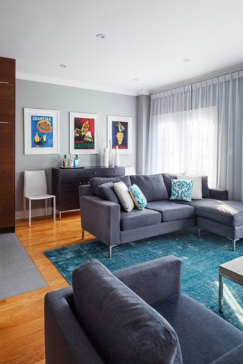 Living Room With Blue Gray Walls Charcoal Furniture Teal Green Area Rug And Oak Floors
