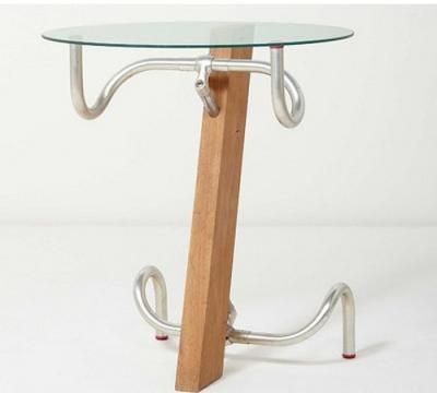 The Handlebar Table designed by Jasper Morrison in 1983. Kind of funky, but I think it could use an update to be current.