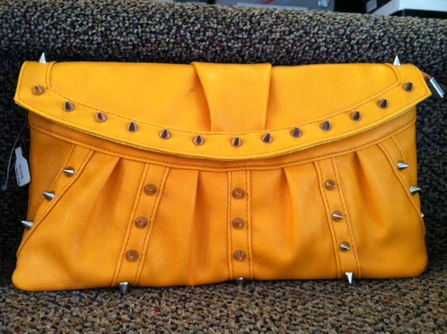 Yellow clutch with silver studded spikes  www.shopartifact.com