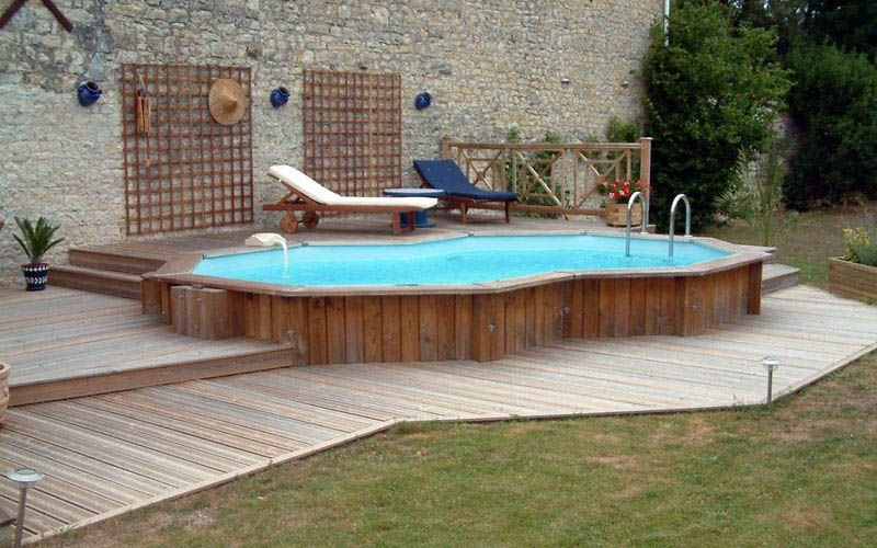Pool Deck Ideas For Inground Pools radiant semi inground freeform with walk in steps and pavers Semi Inground Pools Home Garden Swimming Pool Semi Inground Pools For Your Above Ground Pool Decksabove