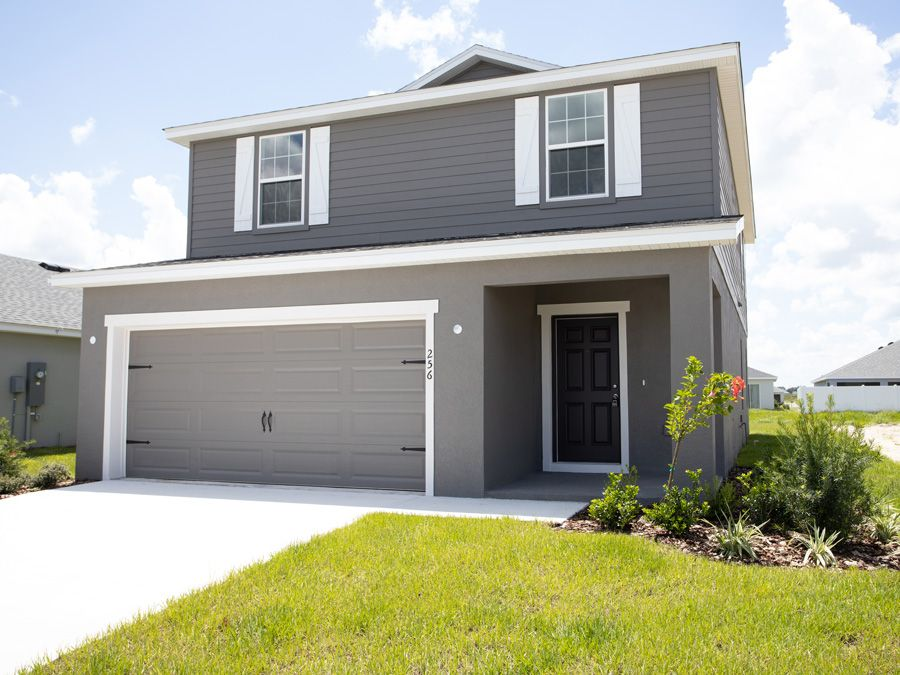 Give us all the beautiful gray exteriors! This darker gray, similar to Urban Bronze SW #2021ColoroftheYear, is a stunning alternative to the traditional home color choices.