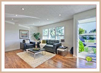 After professional home staging. The dark furniture and greenery compliment the maple flooring.