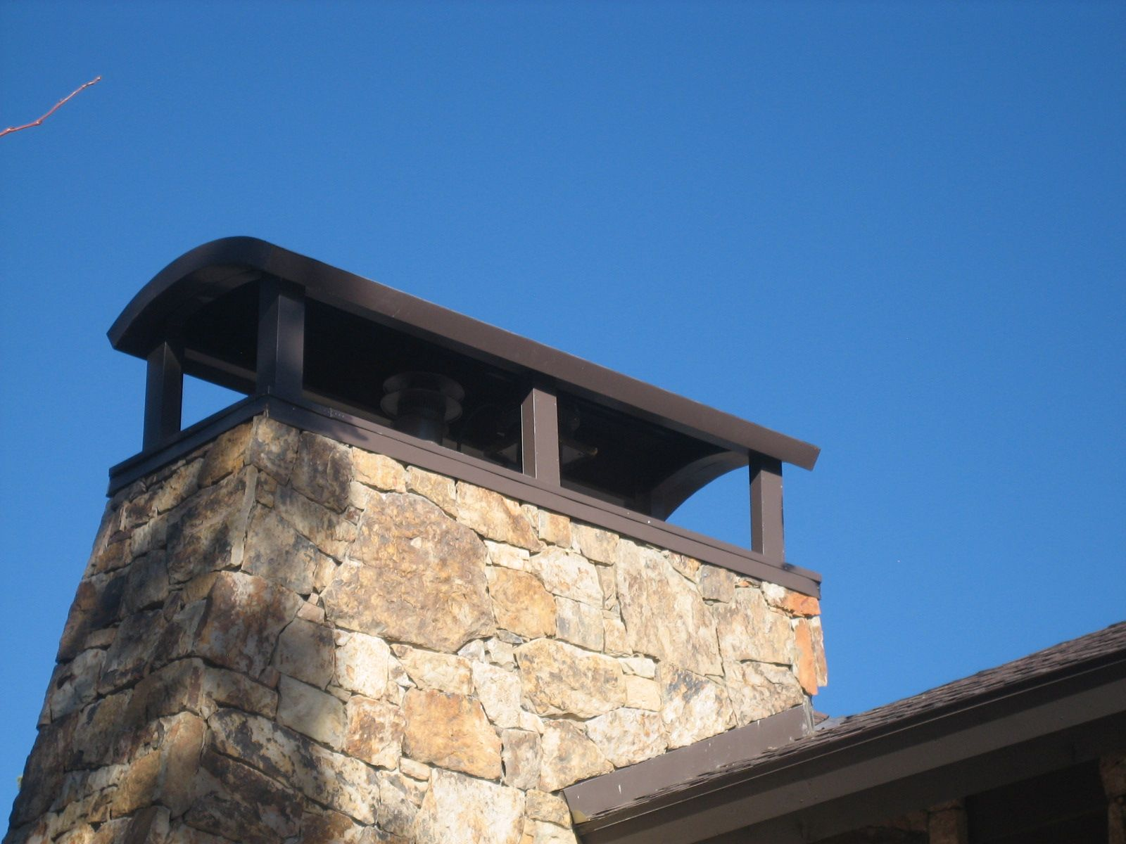 Denver Half Moon chimney crown in Aged Bronze color with matching ...