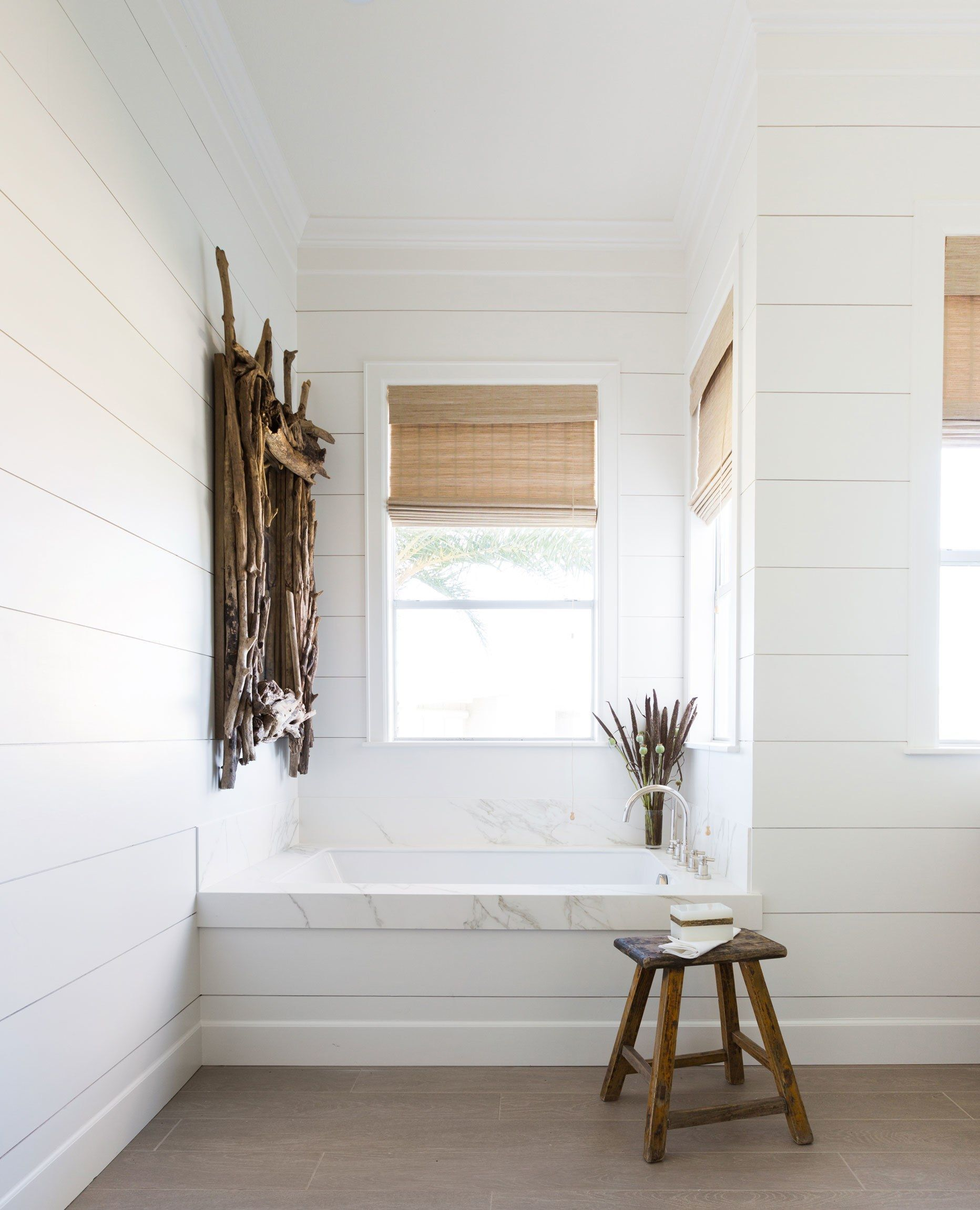 This bathroom has a relaxing and stylish feel with the combination ...