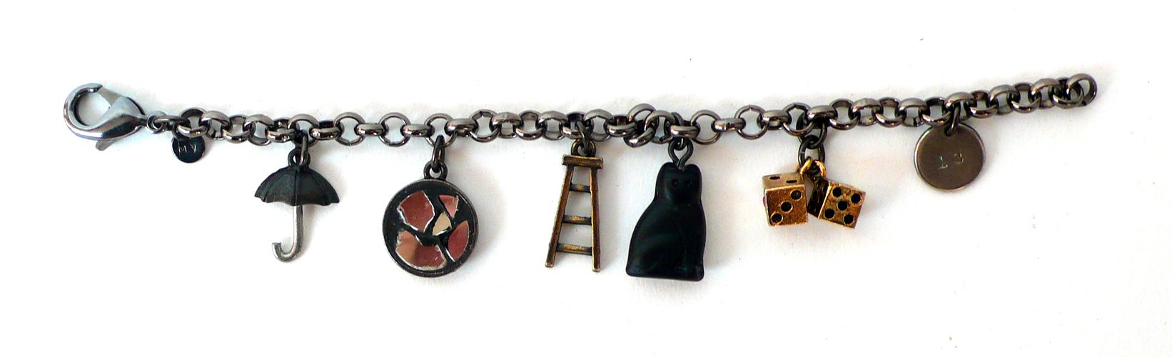 Bad Luck Charm Bracelet  All the worst luck in one place. Open umbrella, broken mirror, a ladder (and you just walked under it), black cat, snake eyes, and the number 13.