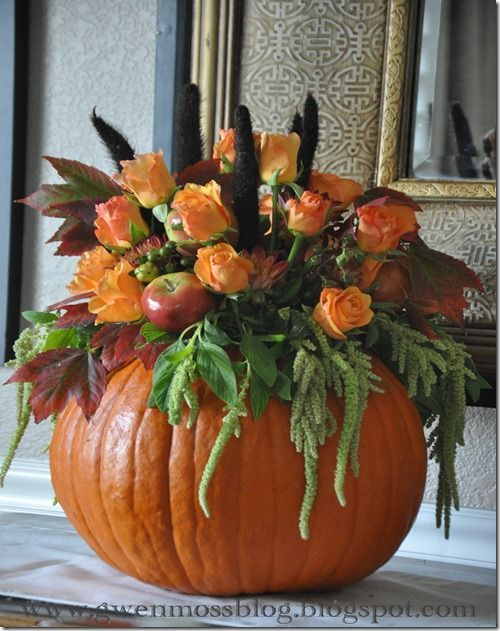 Fall pumpkin floral arrangement with peach roses and apples and amaranth and maple leaves.  Simple and stunning. Great tutorial for re-creating your own, too. pumpkincenterpieces #pumpkinvase #pumpkindecorations #pumpkinflower #centerpieceideas #diypumpkin #pumpkinbouquet #halloweendecorations #pumpkintopiary