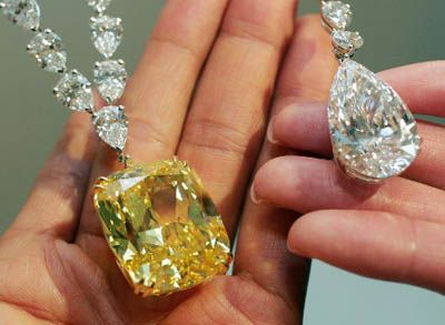 A 100-carat yellow diamond (L) is displayed at British jeweller Graff's collection in Tokyo November 22, 2006. The diamond worth (27.5 million) is part of a jewellery collection worth a total of 423MIL according to Graff Japan.