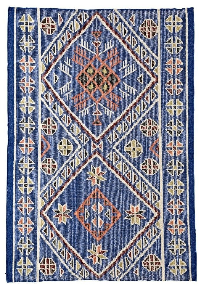 Shop Heritage Rug.  The intricate pattern on this wool rug makes it stylish enough for your own living room, while also allowing it to work perfectly in a kids bedroom or playroom.