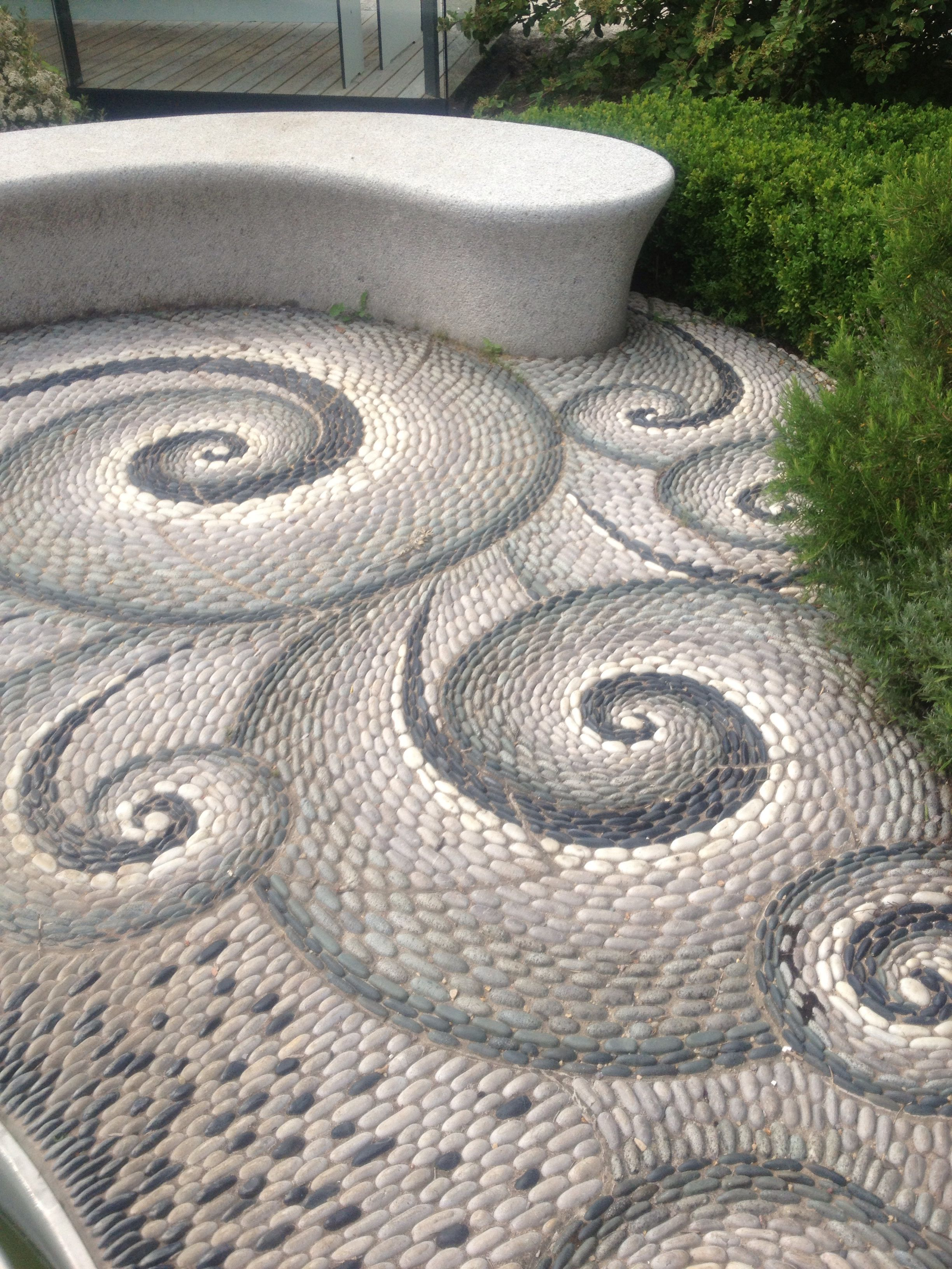Photo of Garden swirls Pebbles cast in concrete to make this arty garden path .