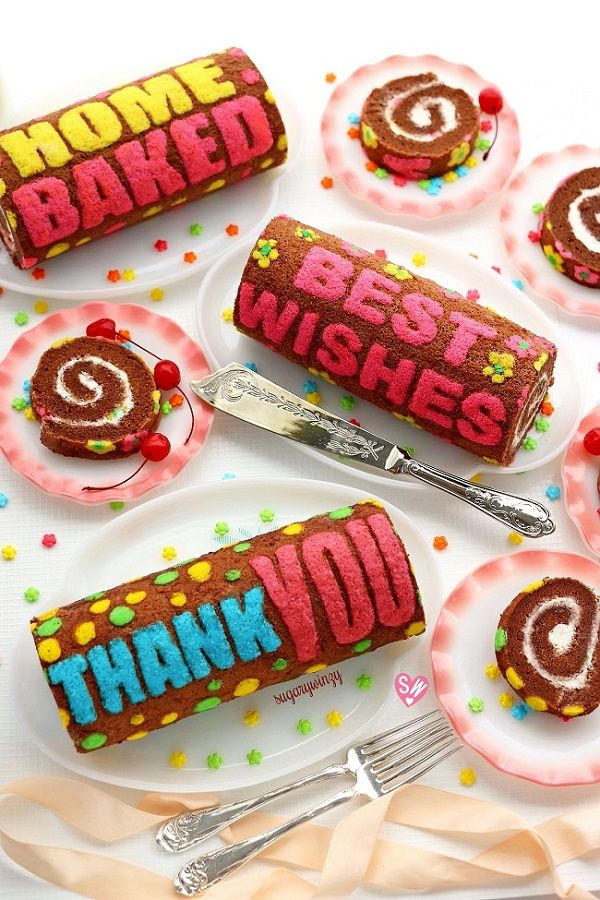 Baked messages on chocolate roll cakes.  http://sugarywinzy.com/home-baked-best-wishes-thank-you-chocolate-roll-cake/