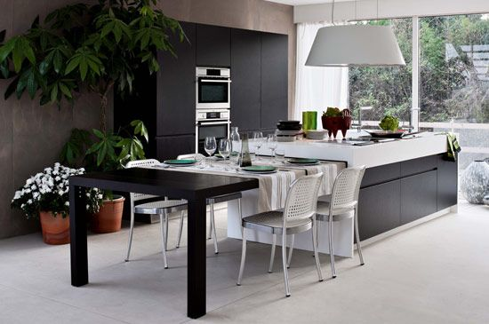 The Functional And Adaptable Monoblocco Island A White Kitchen Island With Black Kitchen Island Dining Table Kitchen Renovation Trends Dining Table In Kitchen