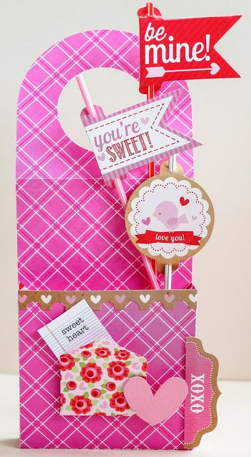 How cute for the kids doors on V-Day morning!  I think the CTMH Art Philosophy Cricut Cartridge has a door hanger with a pocket!