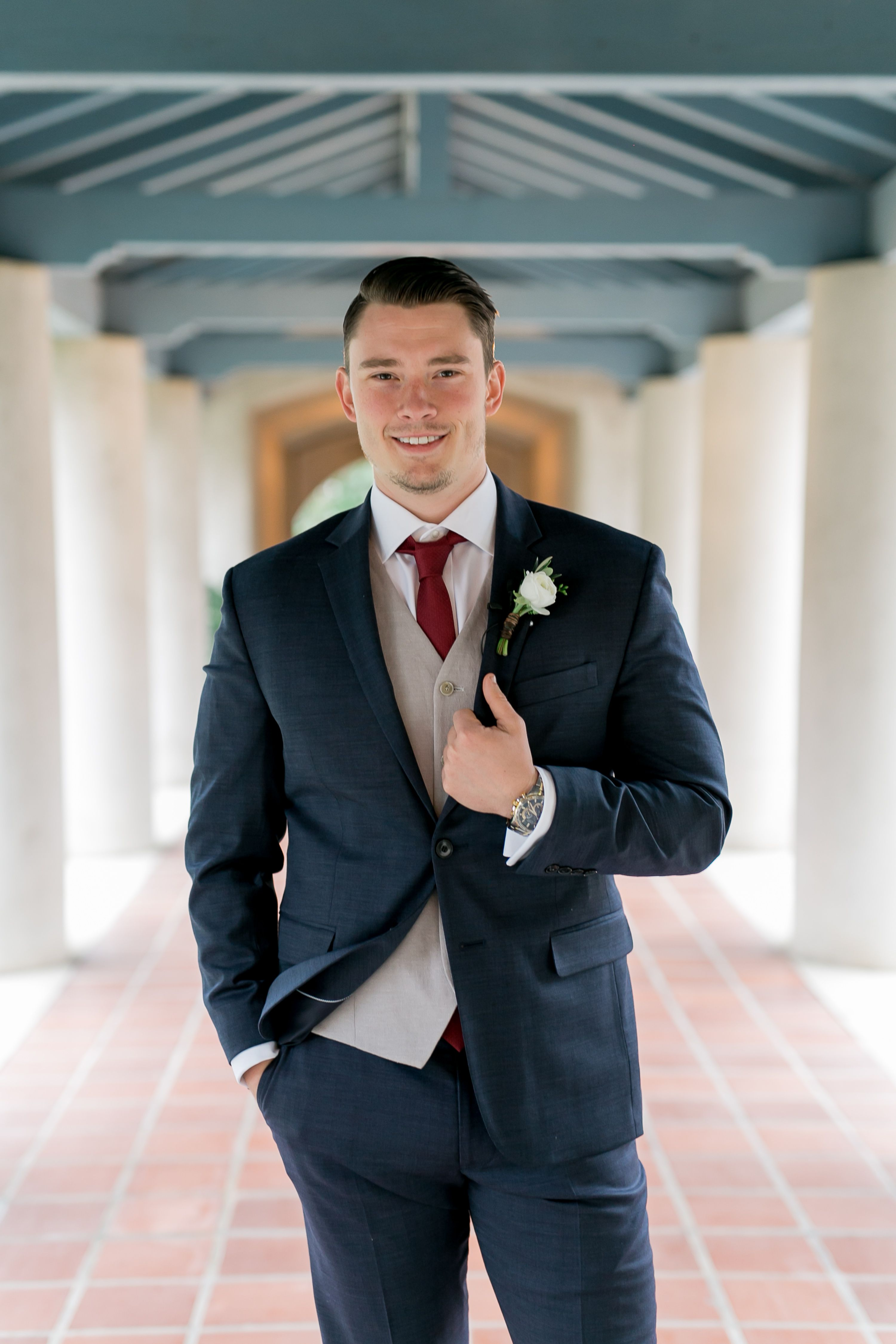 The groom wore a navy blue tuxedo complemented by the
