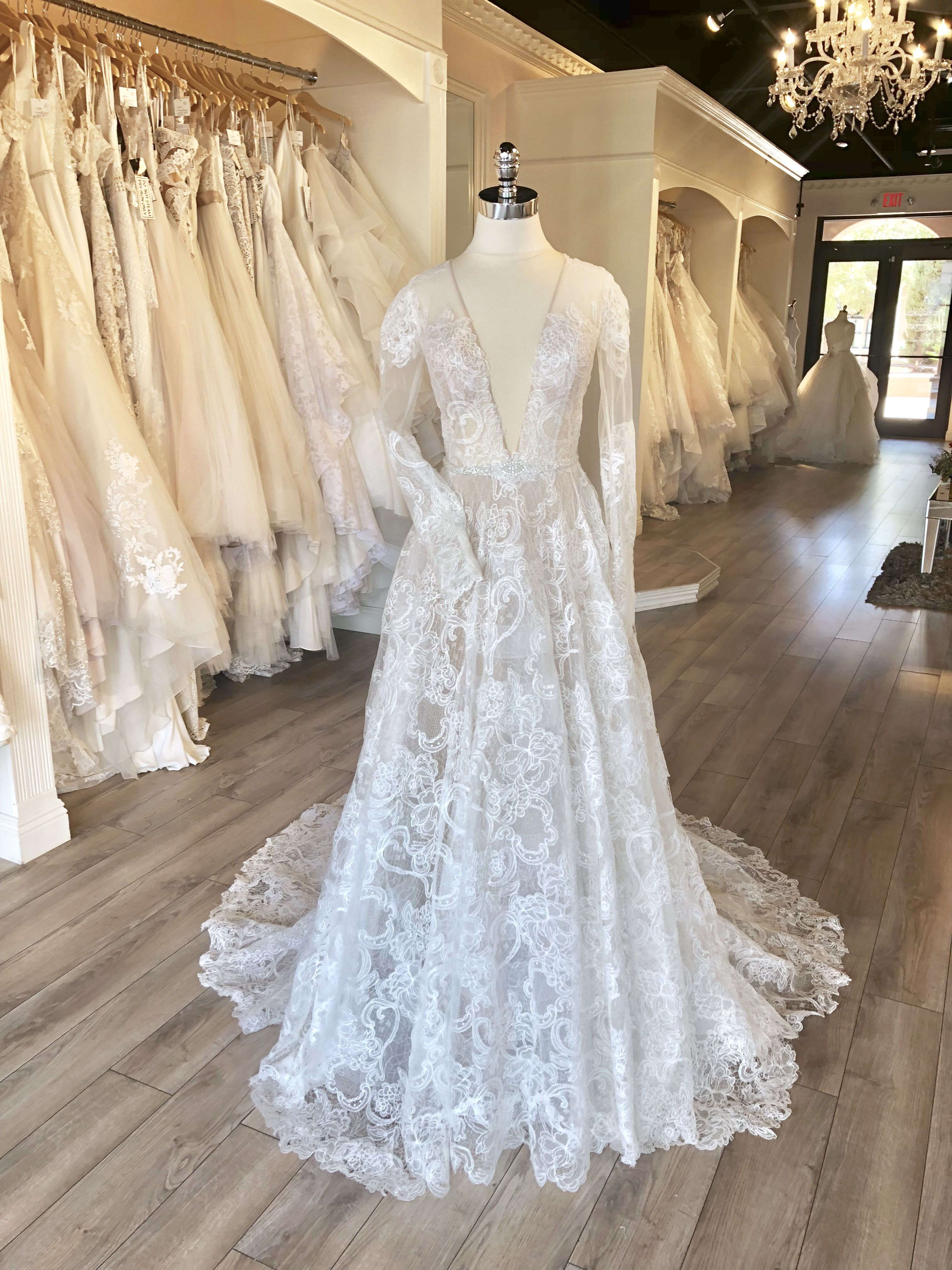 Long sleeve lace weddingdress with deep v low back and aline