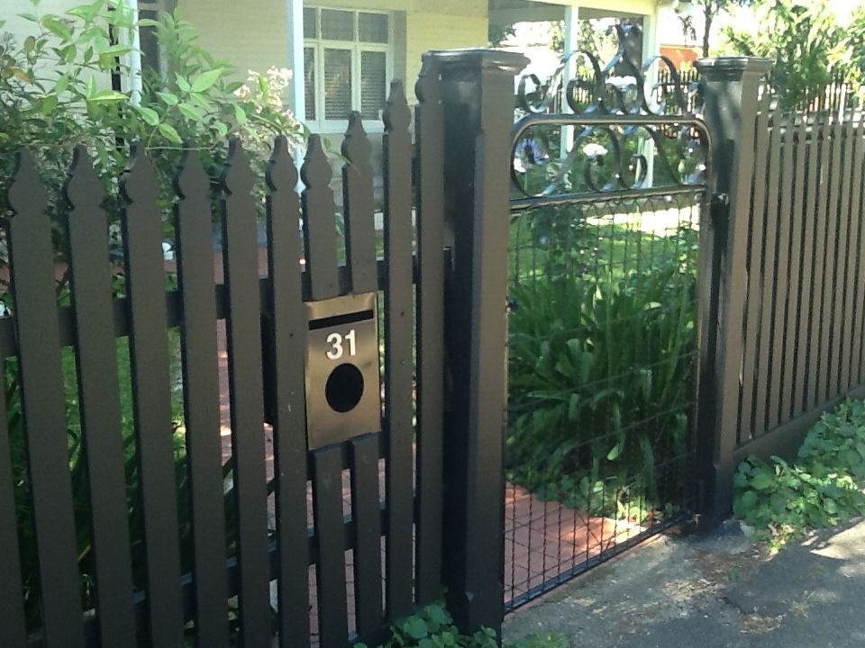 Black Picket Fence With Emu Wire Gate Outside
