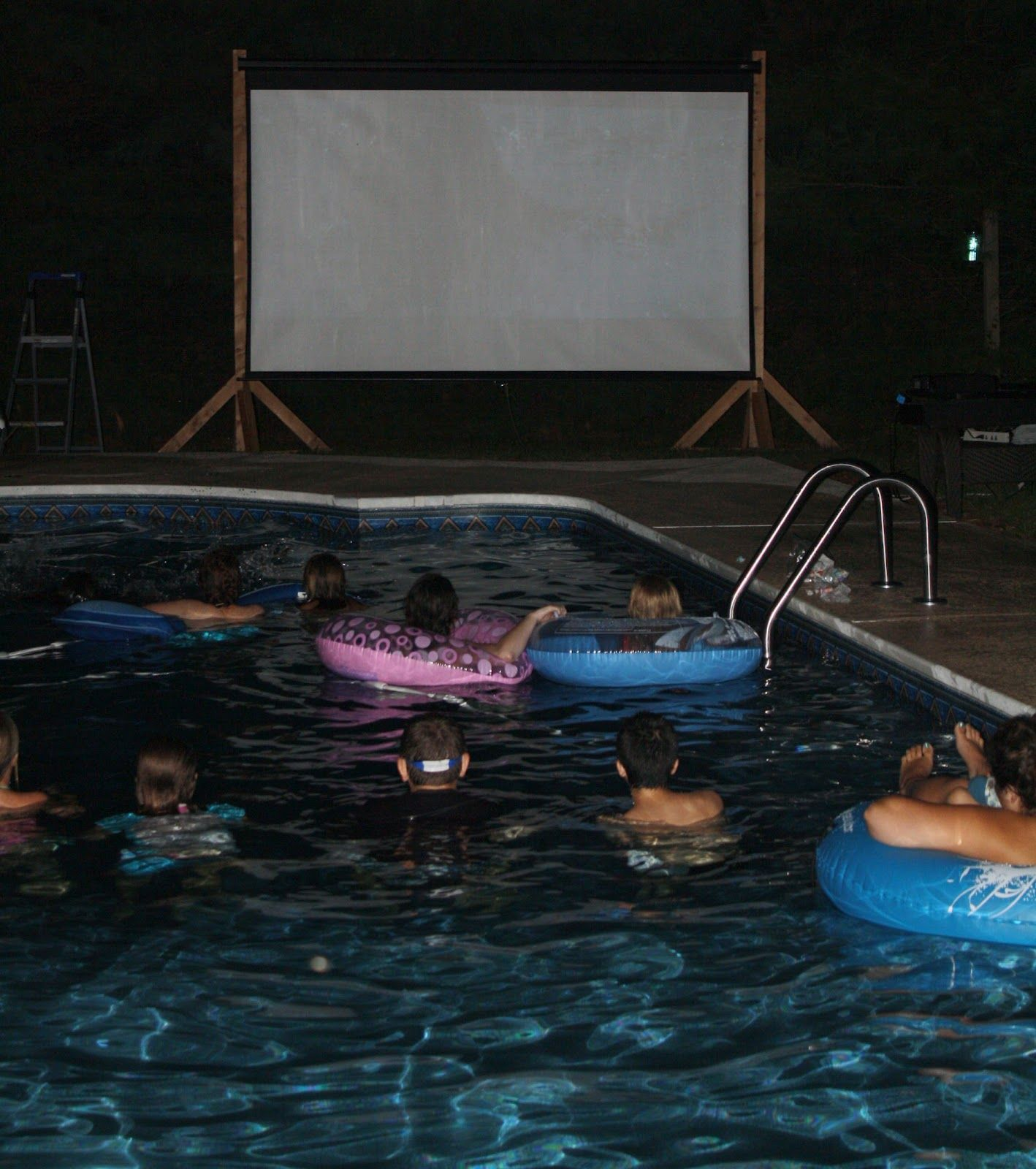 Our Shark Week. DIY movie screen by pool to show 'Jaws