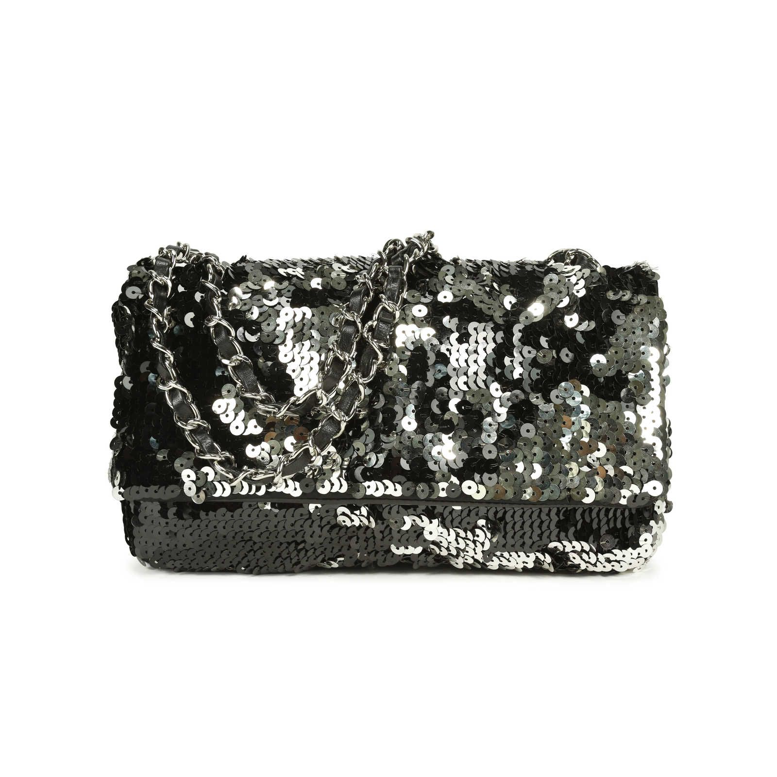 bcb9c1fd0119 A rare, limited edition piece, this Summer Night Flap Bag from Chanel  features the