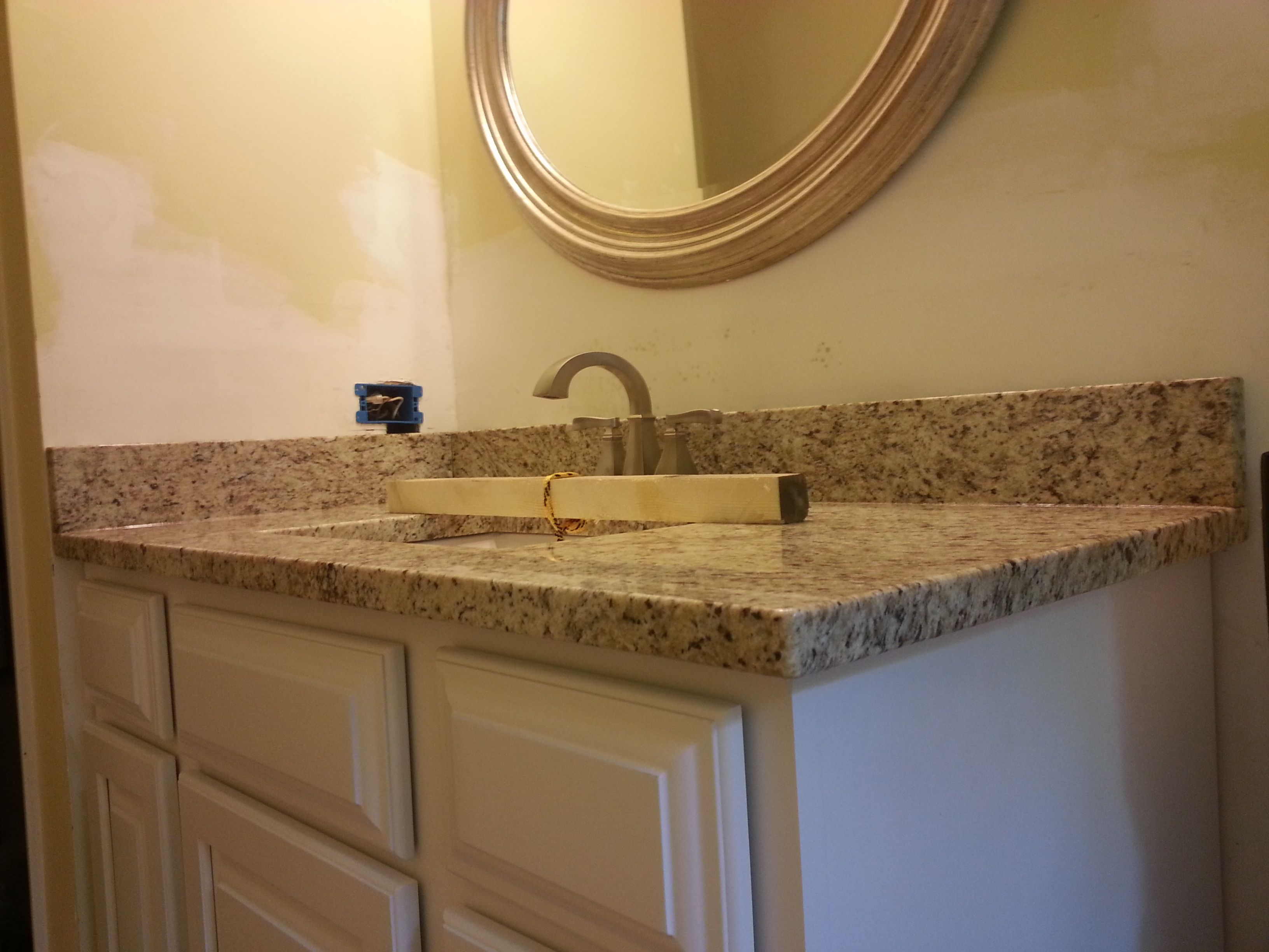 giallo ornamental granite bathroom vanity install for the van beke family knoxvilles stone interiors - Bathroom Cabinets Knoxville Tn
