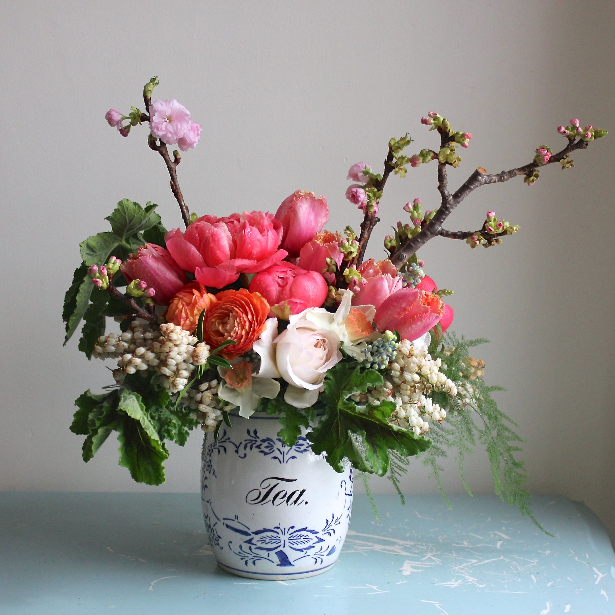 Spring Floral Arrangement By Sachi Rose Includes Cherry Blossom Branches Coral Peonies Cream
