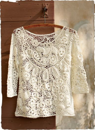 A garland of lace flowers are caught in a netting of pearl white pima. Crocheted entirely by hand, this extraordinary piece is detailed with 3⁄4-sleeves and picot trim.
