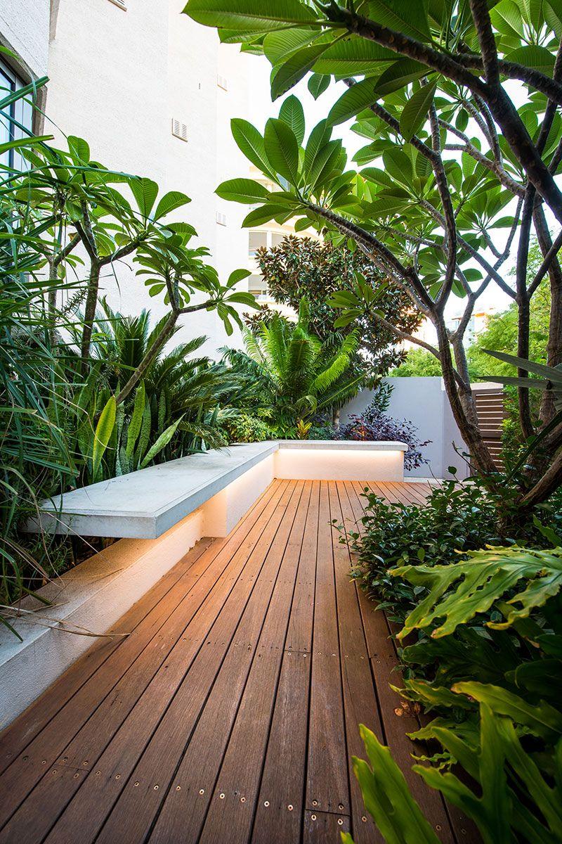 Outdoor cantilevered seat in lush garden Garden