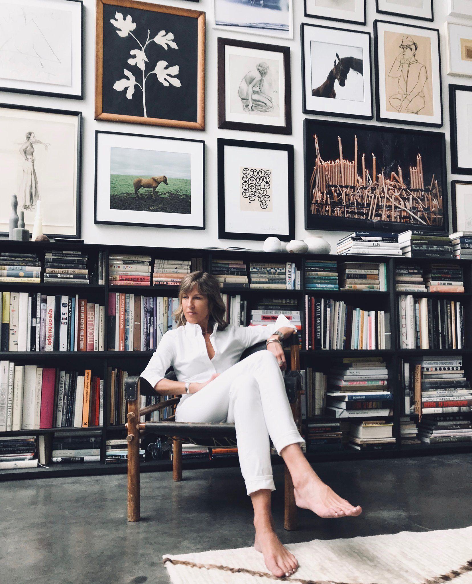 Julia Leach in a room full of books and visuals