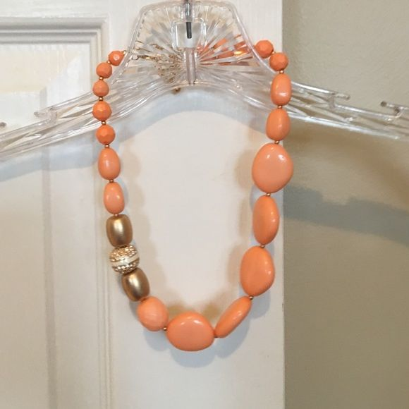 Orange and Gold Necklace Orange and gold necklace. Maybe worn once or twice. Jewelry Necklaces