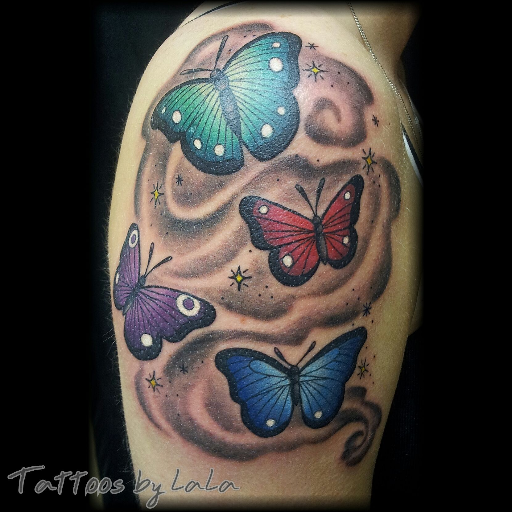 butterflies on upper arm by Alana Rae Rempel Tattoos