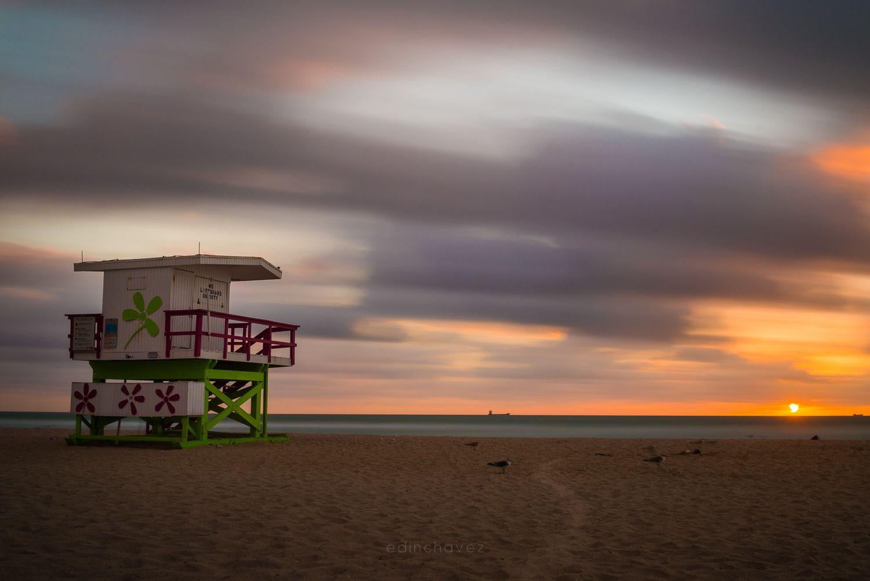 The sun rises over Miami Beach painting the sky orange