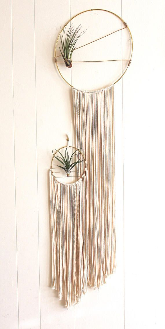 Macrame Wall Hanging for Air Plants.. ..DESCRIPTION.. This macrame air plant holder is handmade with cotton cord and wrapped with gold-tone aluminum wire. Place this holder in your office, above your bed, or show it off in your living room. Put it anywhere that does get