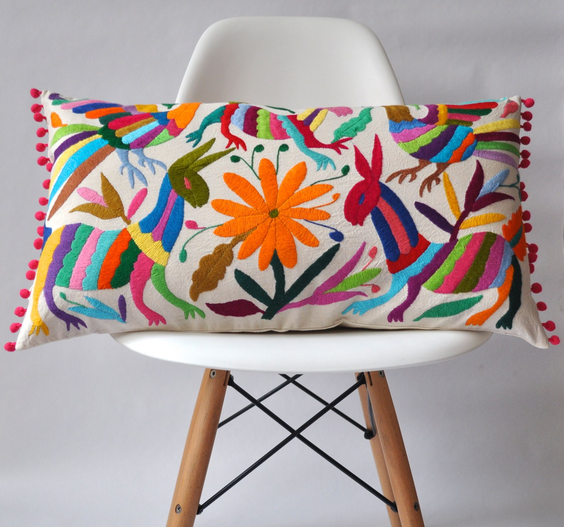 Otomi pillow cover multi coloured pompom to create mexican folk