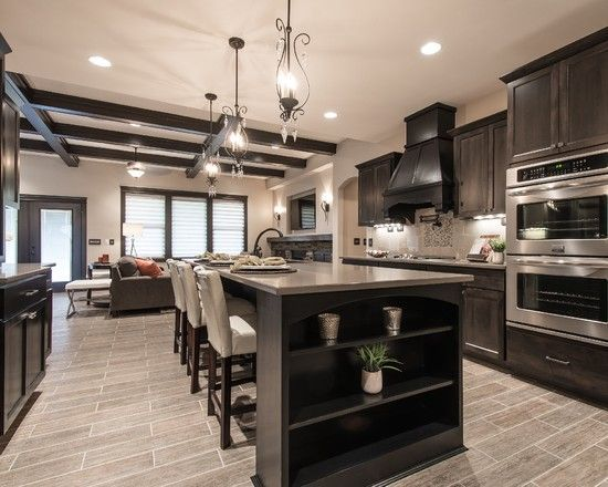 Living Room Kitchen Open Concept With Light Wood Floor Dark Cabinetry
