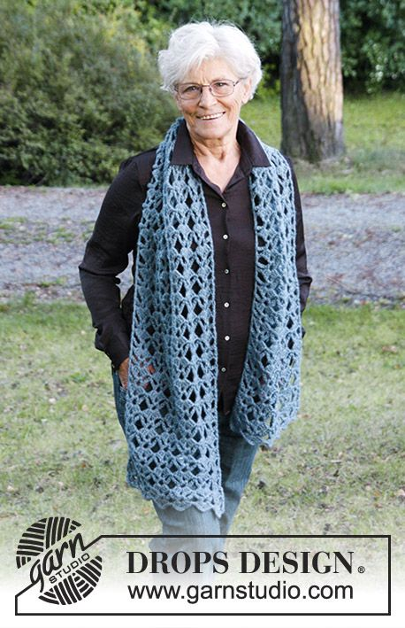 Crochet scarf with lace pattern. Piece is crocheted in DROPS Air ...