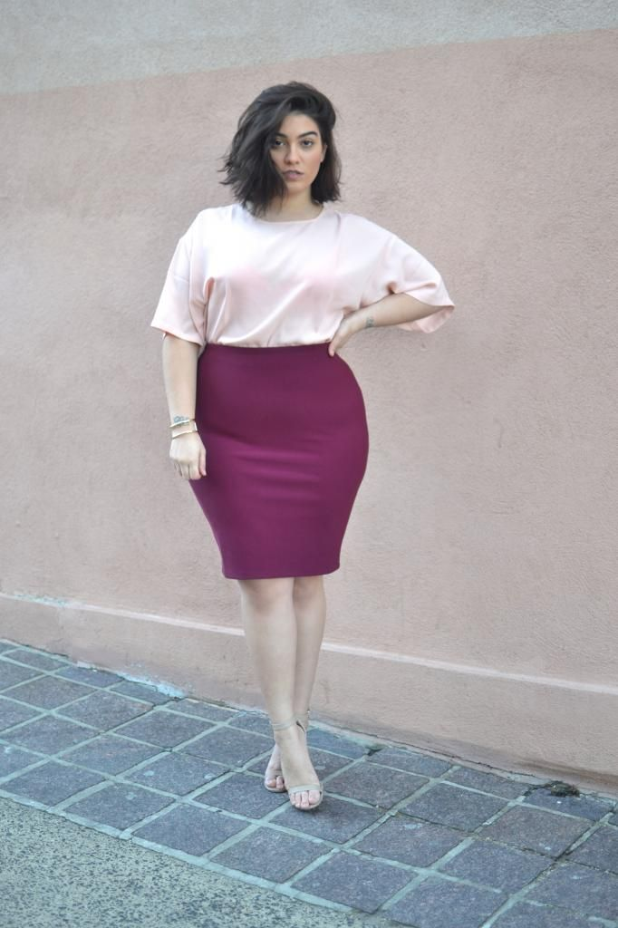 10464cc2ee9 Curvy style inspiration  Pair a vibrant pencil skirt with a hue in the same  color family.