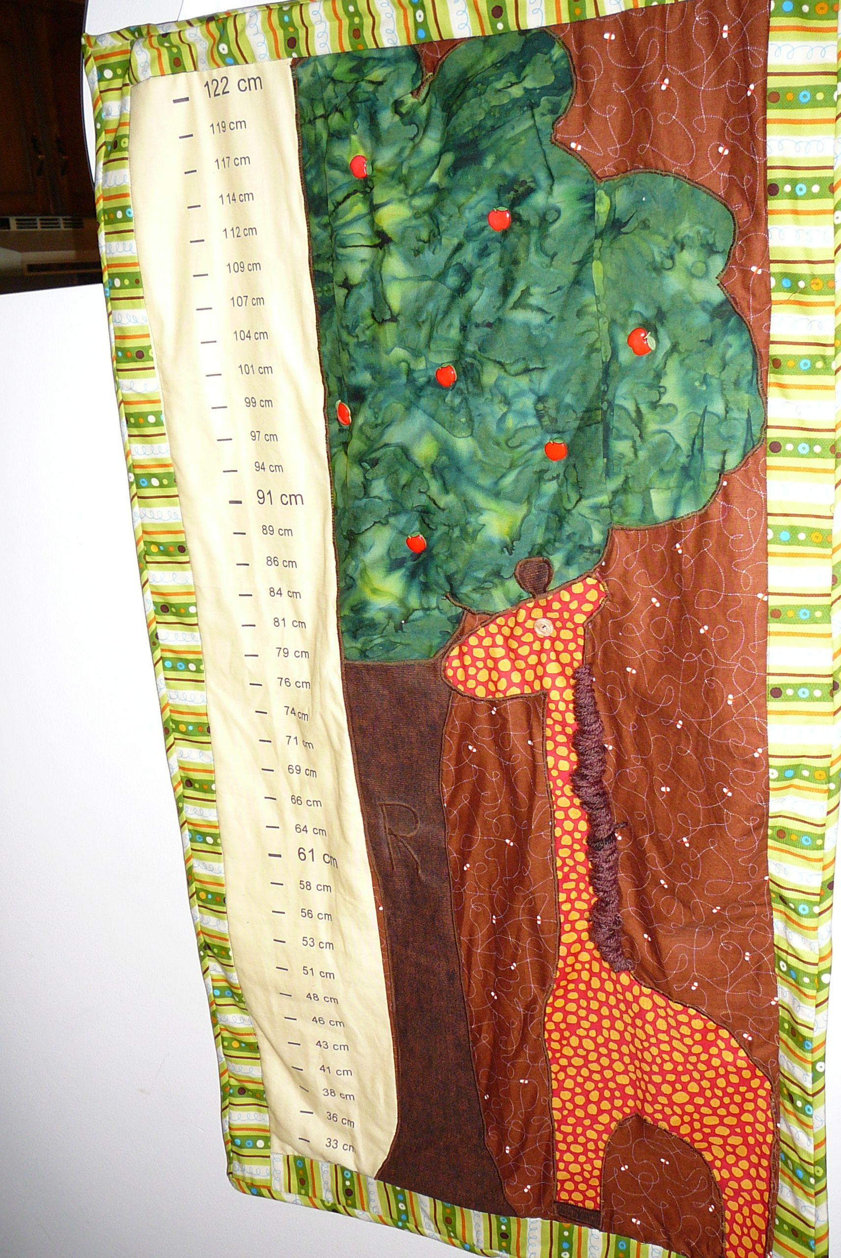 Baby growth chart with babys initial in the tree bark i