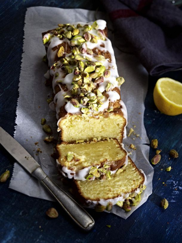 Lemon mascarpone cake with icing and salted pistachios -