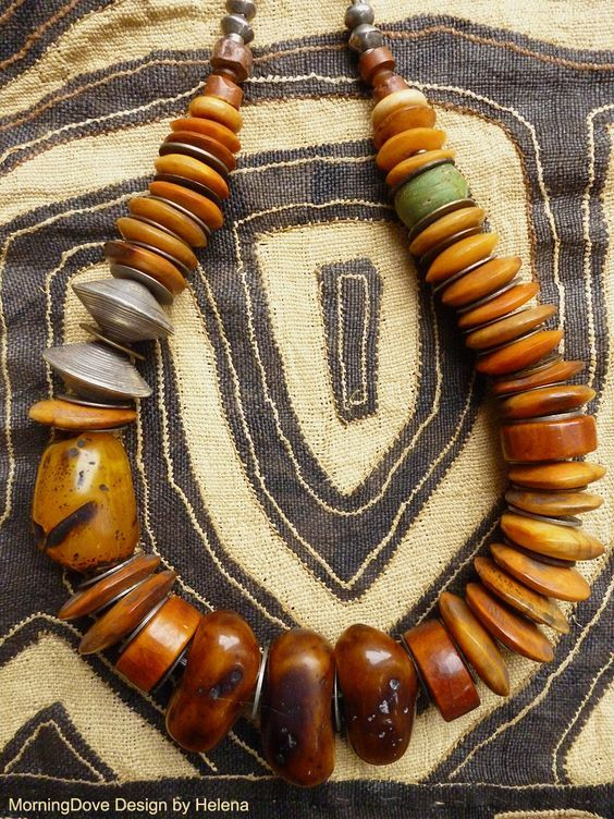 by Helena Nelson-Reed | Old African bone buttons which have been lovingly polished, an antique glass Hebron bead, several thick antique Tibetan bone beads, antique Ethiopian coin silver beads, contemporary mock amber and large contemporary fine silver beads from the Hill Tribe.